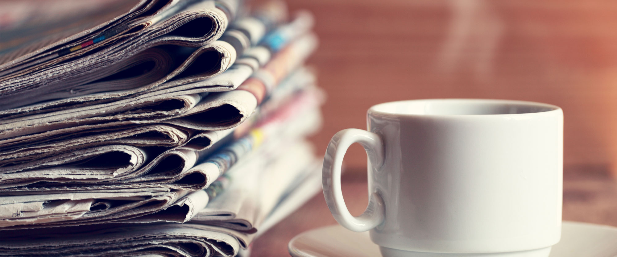 news papers and coffee